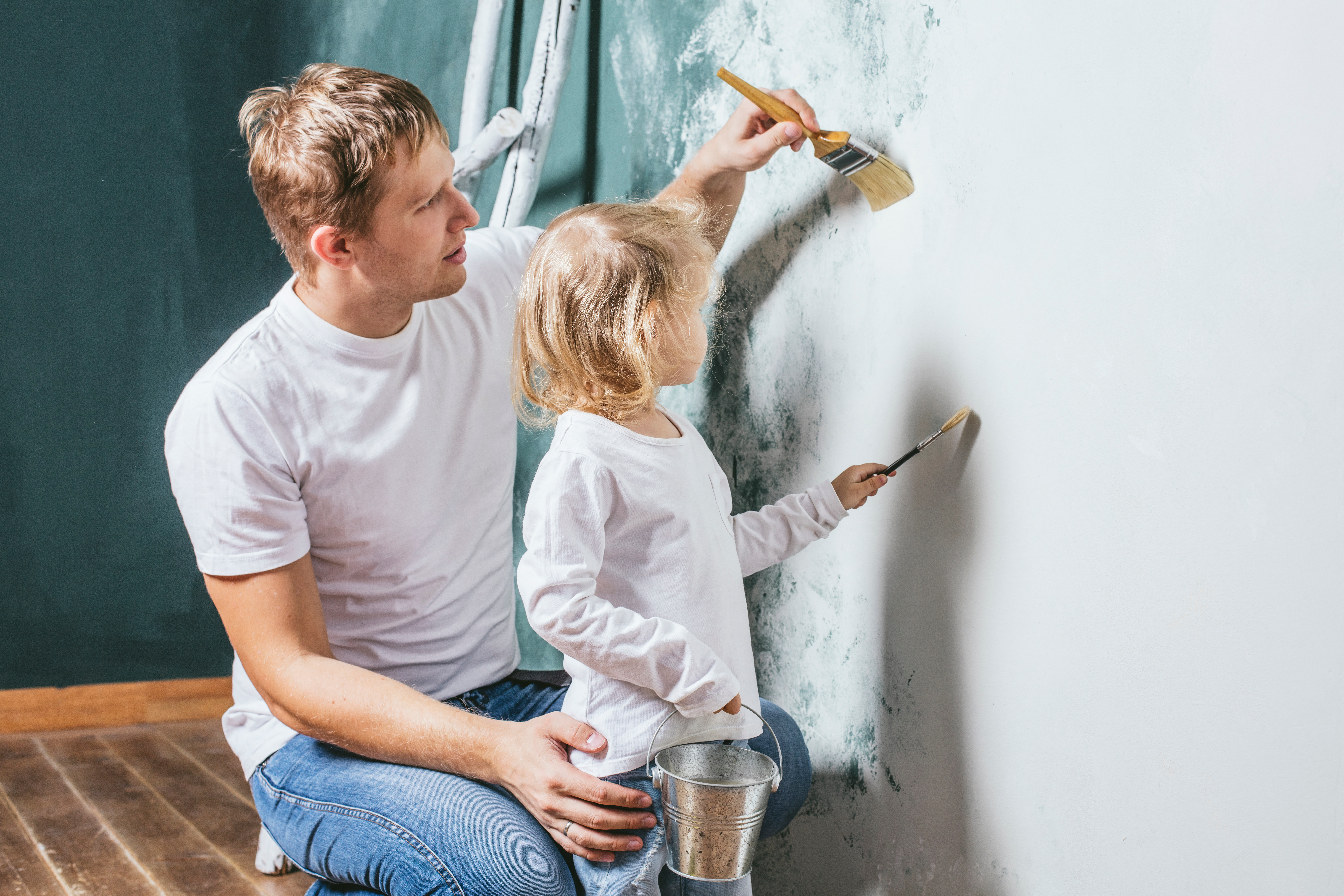 Dad and daughter paint house